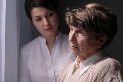caregiver comforting elder woman